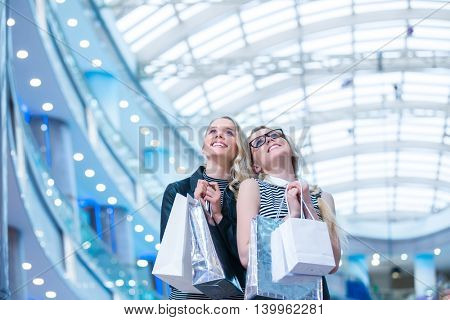 Smiling women in a store