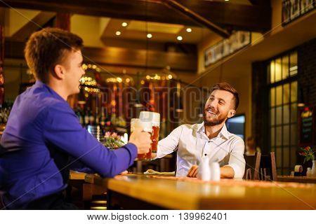 Smiling men in a bar
