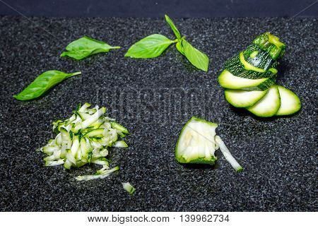 Making strips zucchini and young zucchini with slice isolated on black background. Top view.