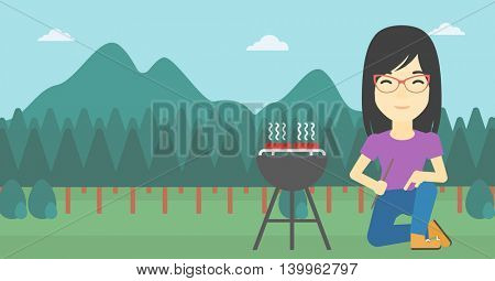 An asian young woman sitting next to barbecue grill in the park. Woman cooking meat on the barbecue grill. Woman having a barbecue party. Vector flat design illustration. Horizontal layout.