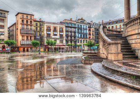 Colorful houses on Plaza del Castillo in rainy day Pamplona Navarra Spain