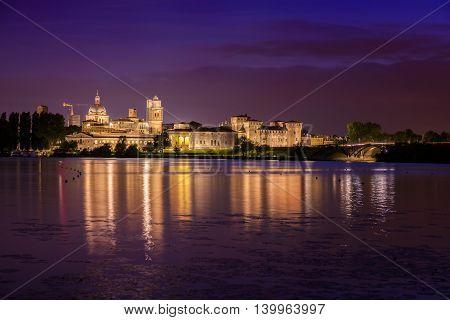 Mantua, Italy - June 21, 2015: Mantua night skyline on river