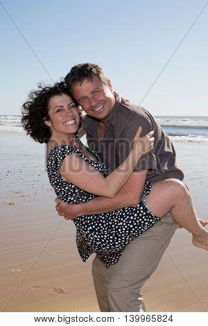 Happy Couple On Honeymoon Holiday - On The Beach