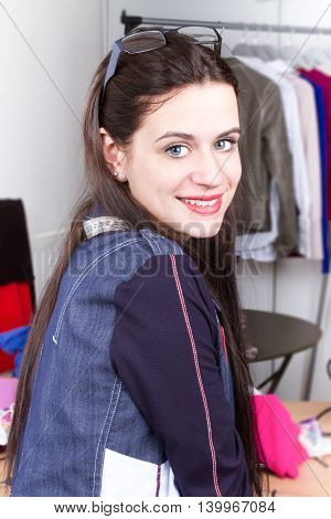 Portrait Of Smiling Fashion Designer In A Bright Creative Office