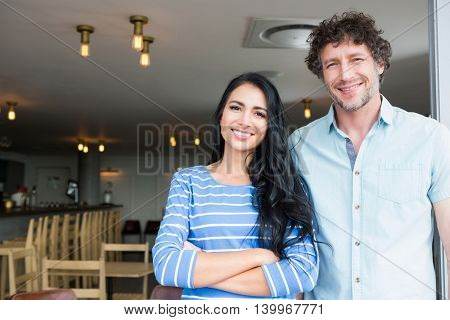Portrait of happy couple standing in cafeteria