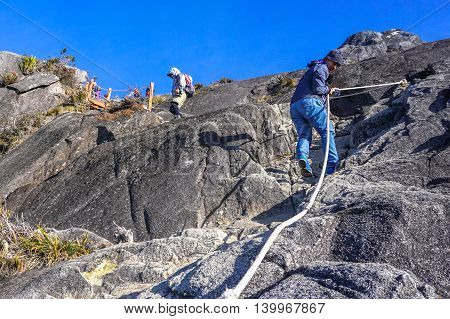Ranau,Sabah, Borneo-March 13,2016: Group of climbers move down from Low's Peak to Laban Rata at Mountain Kinabalu on 13th March 2016.There are two summit trails,Ranau Trail & Kota Belud Trail.