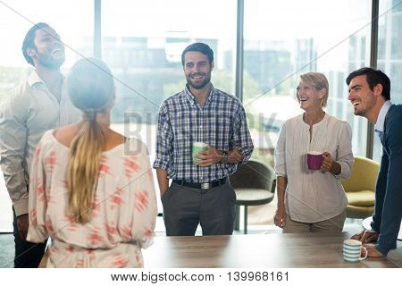 Business people holding coffee mug in the office