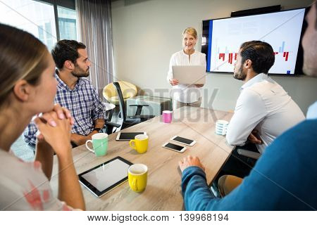 Business people discussing over graph during a meeting in the conference room