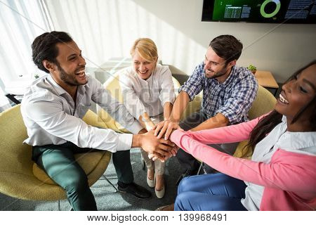 Business people with hand stacked during meeting in the office