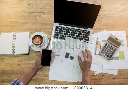 Business man working with laptop and smart phone. top view