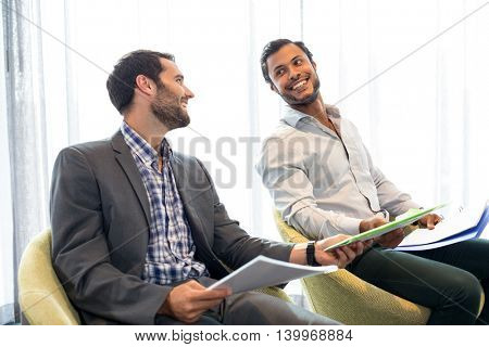 Businessman interacting with coworker in the office