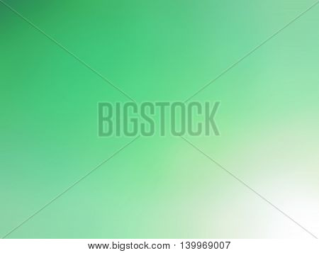Abstract gradient green white colored blurred background.