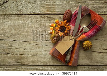 Thanksgiving table setting on rustic wood background, copy space
