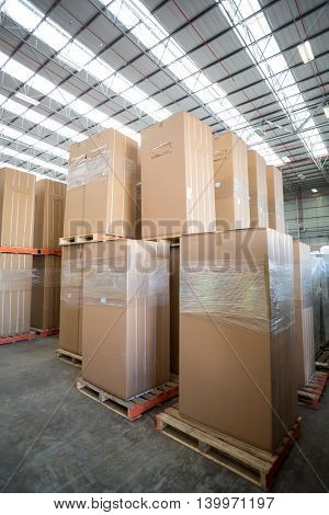 View of cardboard boxes put on pallets in a warehouse