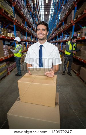 Businessman holding a digital tablet in warehouse