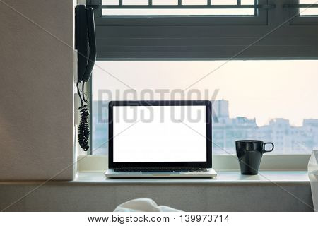 Laptop with blank screen in high floor at hongkong.