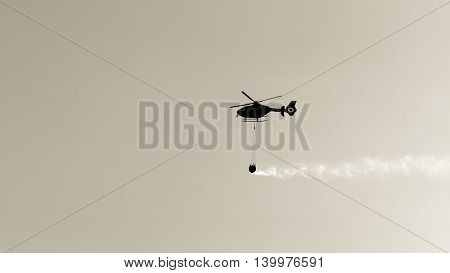 a helicopter fire in action in sky