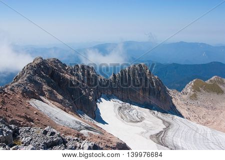 view of the glacier and rocks from the mountain tops Caucasus landscape.