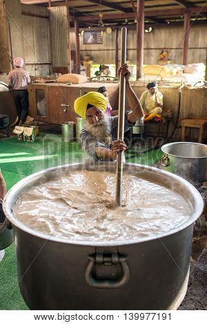 Amritsar, India - March 29, 2016: Unidentified sikh people doing sewa or seva (volunteer work) in the common kitchen of Sikh Golden Temple in Amritsar, India.
