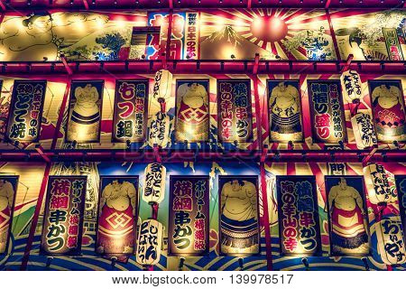 Osaka - July 2016: Colorful artistic building glowing at night. Shinsekai