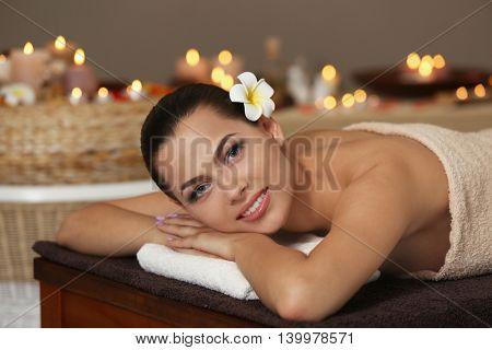 Young beautiful woman in spa salon