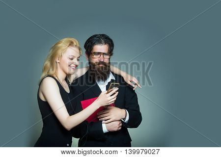 Smiling Couple Look In Smartphone