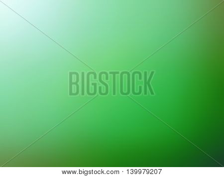 Abstract gradient green colored blurred background design.