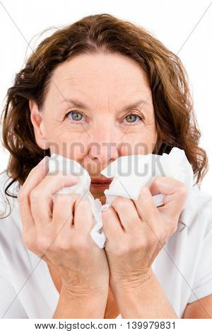 Close-up of portrait mature woman suffering from cold against white background