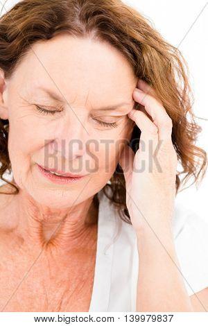 Close-up of mature woman having headache