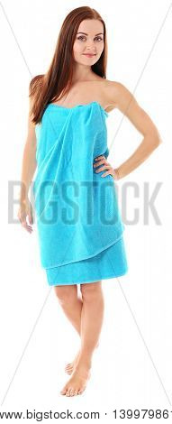 Young beautiful woman wrapped in towel isolated on white