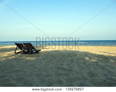 Peaceful beach clear sky white sand and twice beach chair from Thailand