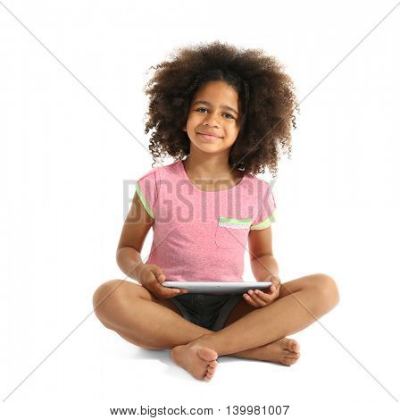Happy African girl with tablet, isolated on white