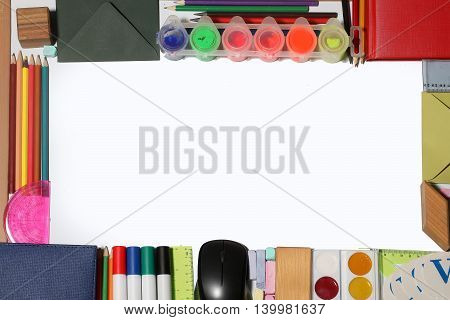 school supplies frame on paper of pencils markers computer mouse chalk ruler paint palette wooden cube envelope notebook and alphabet isolated on white background copy space