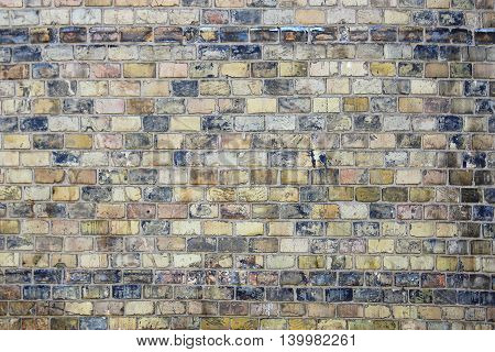 a gray old of brick wall background