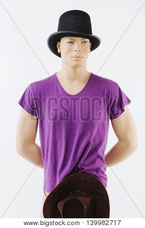 Male mannequin wearing hat and a purple t-shirt - isolated on white