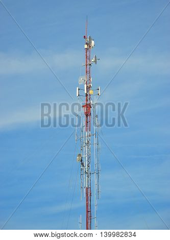 radio pole (telecommunication antenna) on blue sky background