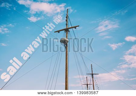 Sail away with me quote on boat mast