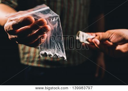 Dealer selling cocaineecstasy or other illegal drugs