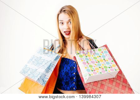 Satisfied woman carrying shopping bags - isolated on white.