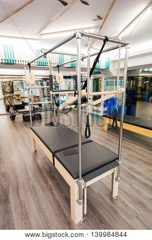 Pose of pilates equipment indoors. Cadillac close-up.