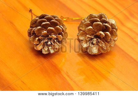 Acorn Christmas decorations isolated on a wooden table