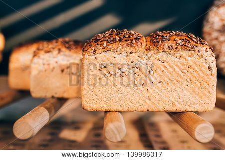View of bread with seeds on bakery's shelf