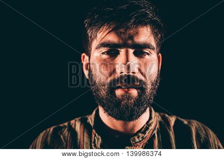 Closeup of a bearded junkie having hallucination