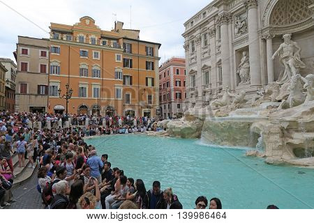Rome, Italy 17 June 2016. Tourists at the renovated Fontana di Trevi. The Trevi fountain, after its renovation, gathers daily large crowds. Tossing a coin here will make you return to Rome.