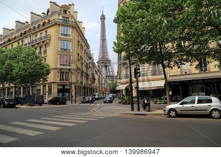 PARIS, FRANCE - MAY 12, 2015: It is Monsyui street leading from Rapp boulevard at the foot of the Eiffel Tower.