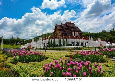 Chiang Mai, Thailand - July 22, 2016: Gorgeous landscaping and flowers around the huge pavilion at the Thai Royal Park Rajapruek.
