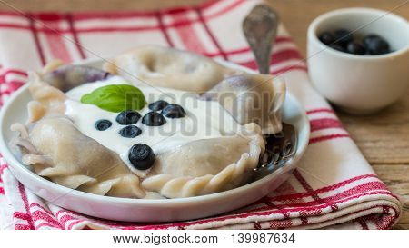 Vareniki. Dumplings With Blueberries. Served With Sour Cream. Selective Focus