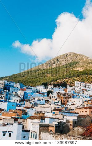 View of the blue city build up on the hill - Chefchaouen Morocco