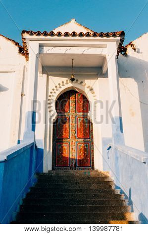 Chefchaouen Morocco - February 9 2015: Wood painted door in the blue city of Morocco
