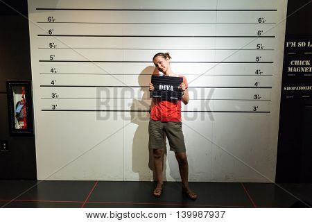 Los Angeles CA USA - July 6 2013: Young beautiful woman convicted as diva is posing inside Madame Tussaud's Hollywood exhibition.